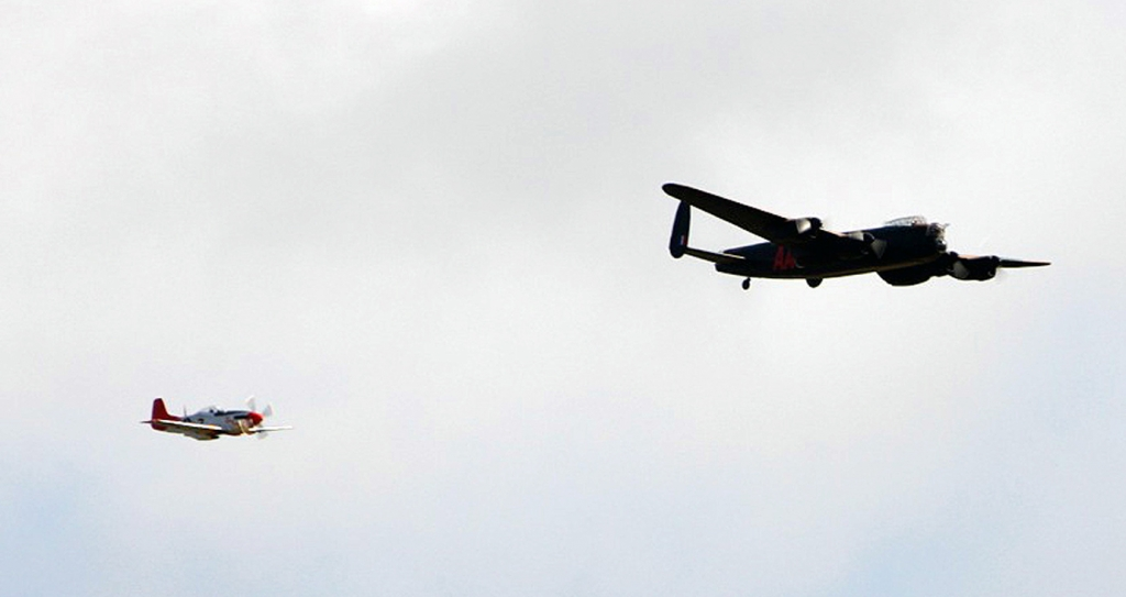 Lancaster and Mustang in a low fly-by